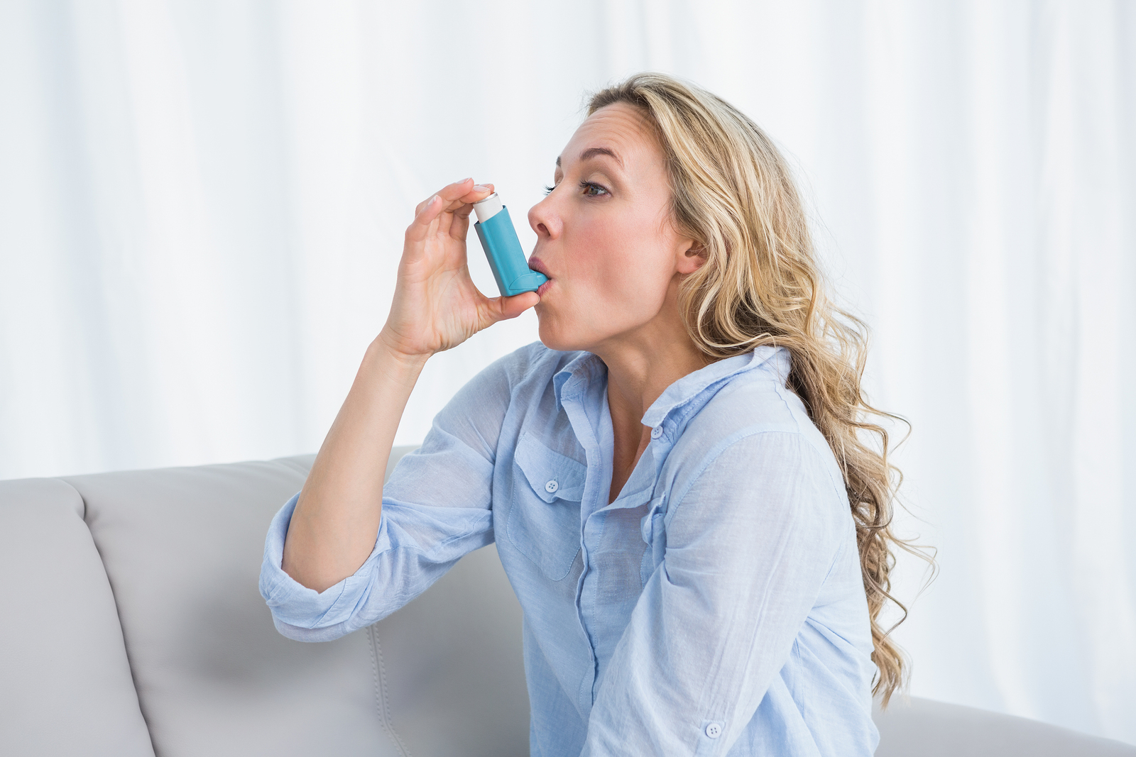 bigstock-Blonde-using-her-asthma-inhale-82664480-2